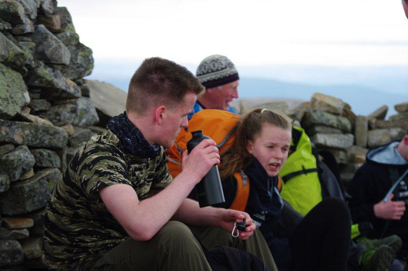 Jake Duncan Bathgate Academy grabs a drink on a hill summit during the selection weekend